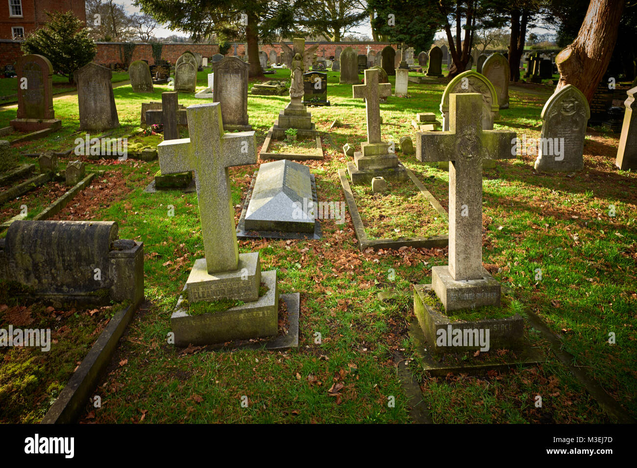 Tombstones in St Mary's churchyard in Acton, Cheshire - Stock Image