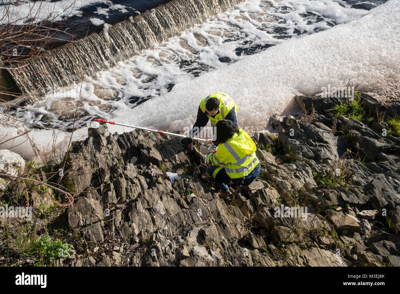 River pollution. Collection of Tejo river water samples and foam to determine the degree of pollution caused by - Stock Image