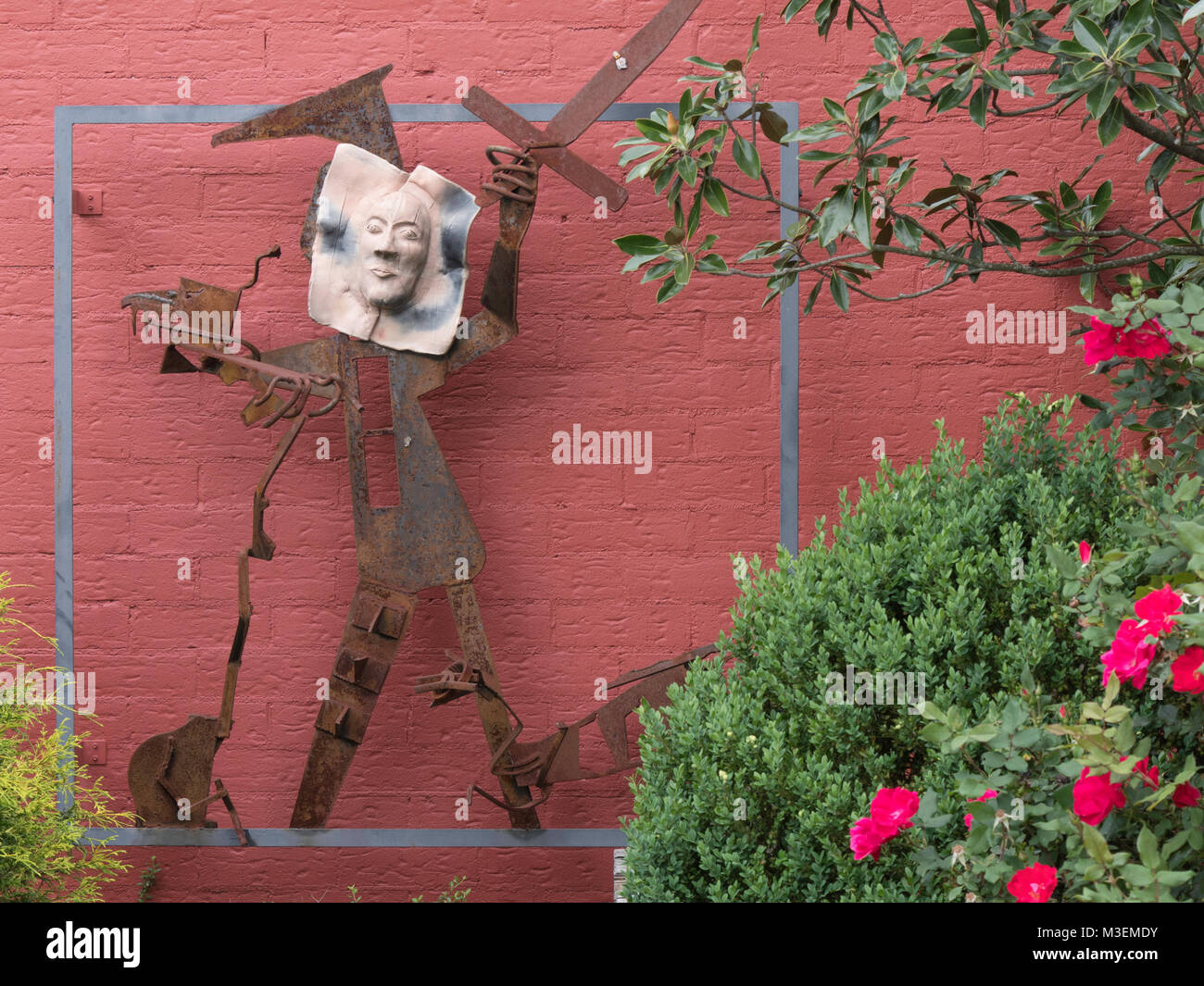 Asheville, North Carolina - May 4, 2017: Multi media sculpture of a human figure is on the side of the Asheville - Stock Image