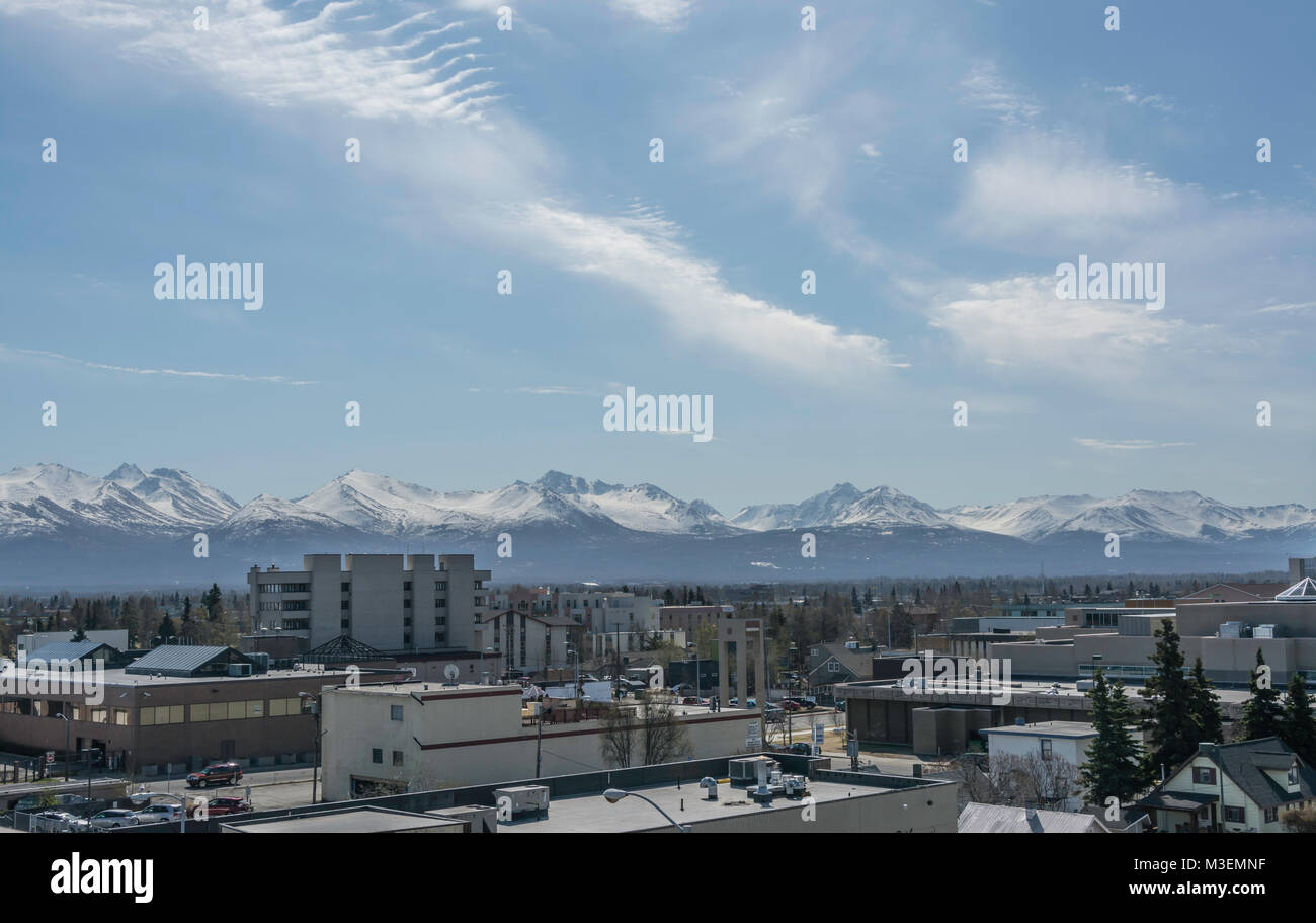 looking over the rooftops of downtown Anchorage Alaska toward the Chugach mountains - Stock Image
