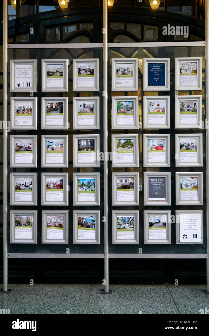Properties photos with price displaying the windows of a real estate agency office.Manhattan.New York City.USA - Stock Image