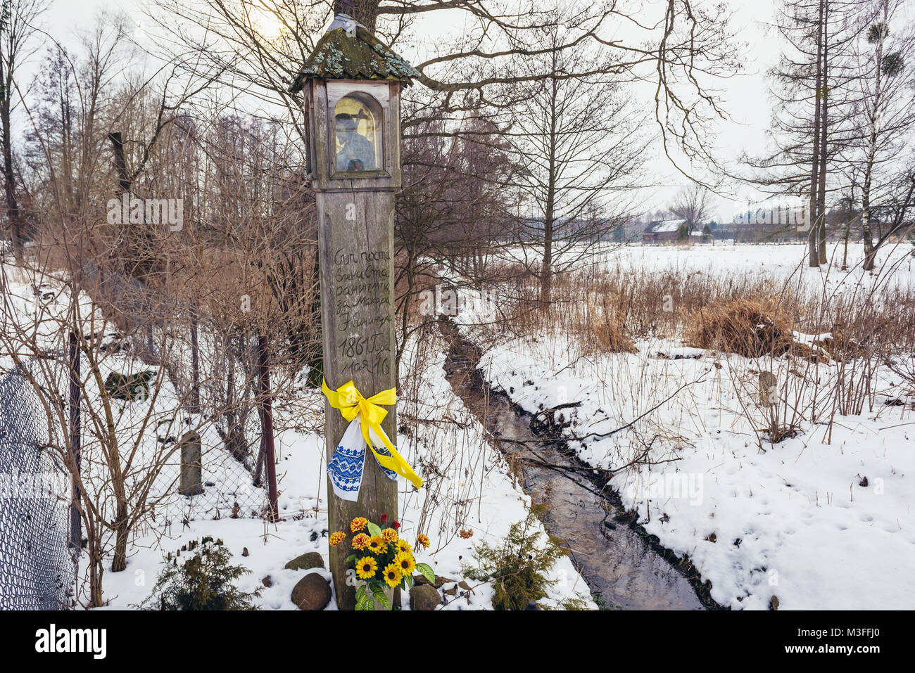 Old wayside pole shrine in Soce village on so called The Land of Open Shutters trail, famous for traditional architecture - Stock Image
