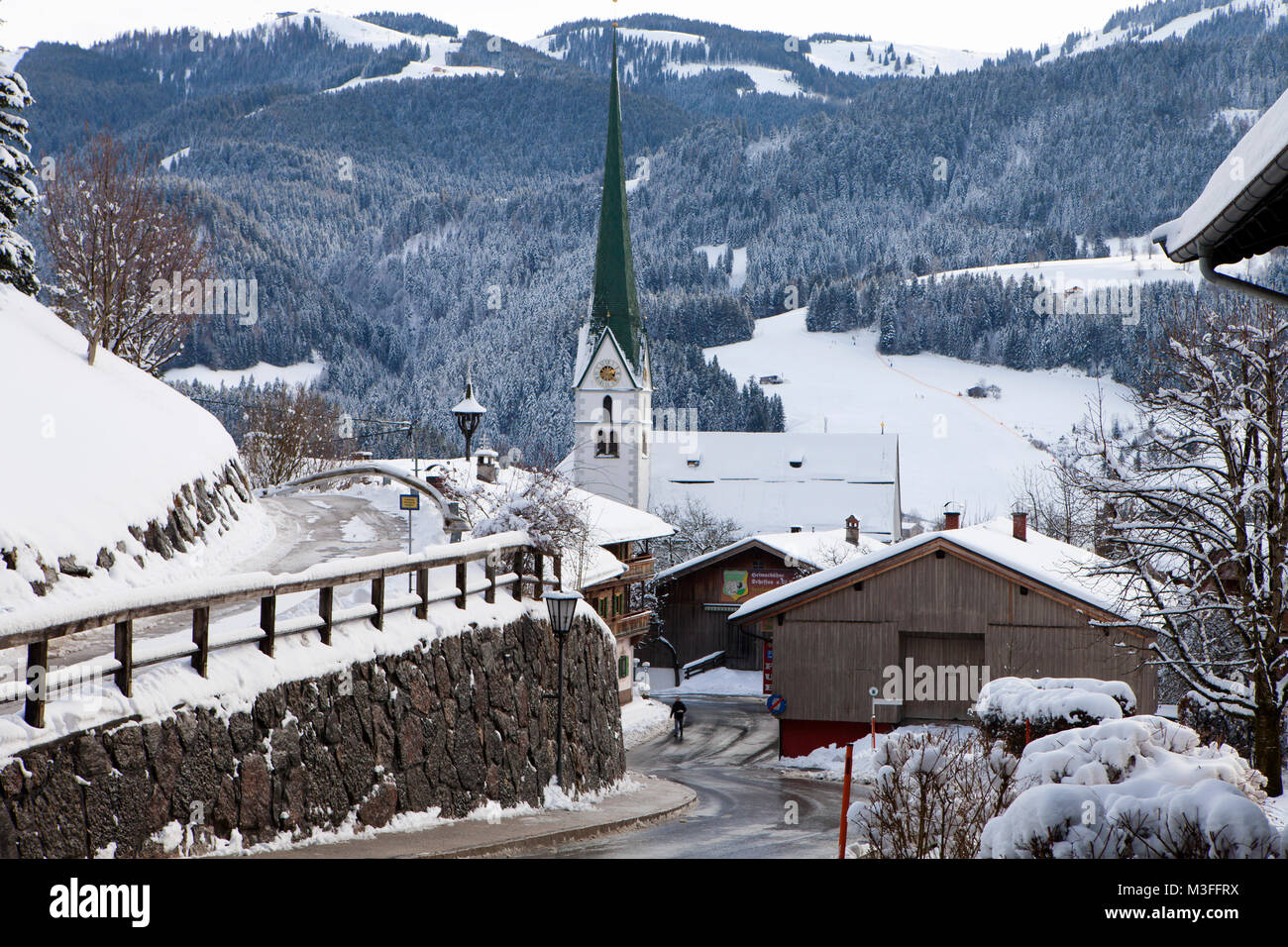 SCHEFFAU, AUSTRIA - JANUARY 18th, 2018: Ski resort of Sceffau gets govered with fresh snow. Scheffau is a pretty - Stock Image