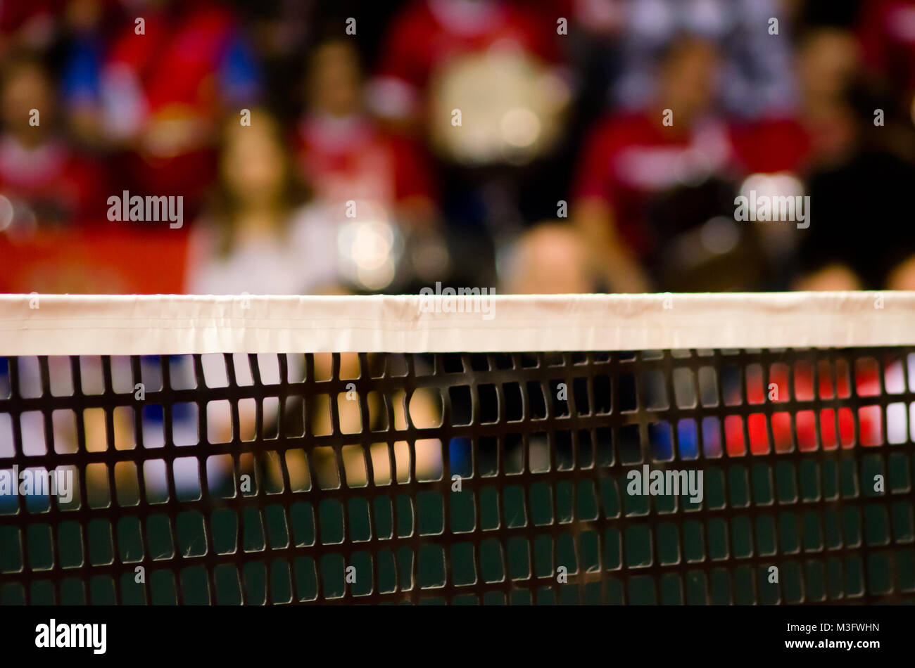 Tennis net close up, horizontal. blurred background - Stock Image