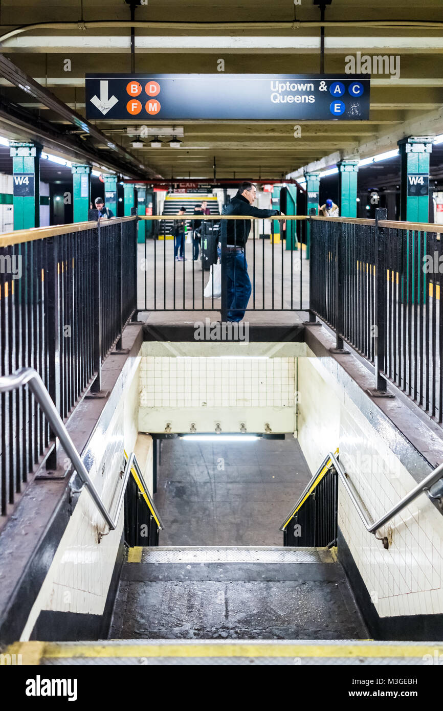 New York City, USA - October 28, 2017: Underground transit empty large platform stairs down in NYC Subway Station, - Stock Image