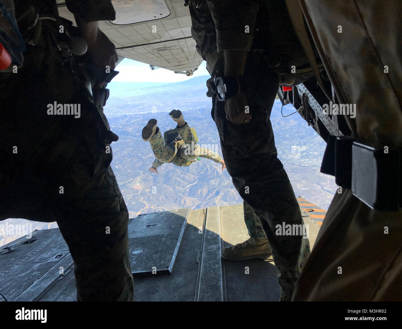 Marines with 1st Marine Reconnaissance Battalion execute a 10,000-foot jump from a CH-53E with Marine Heavy Helicopter Stock Photo