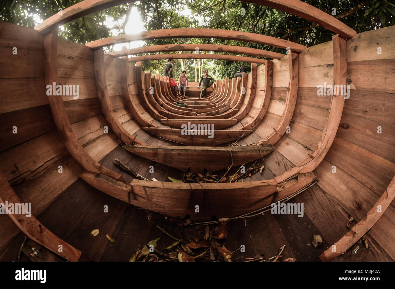The traditional Sulawesi wooden fishing boat are being made by local fishermen. - Stock Image