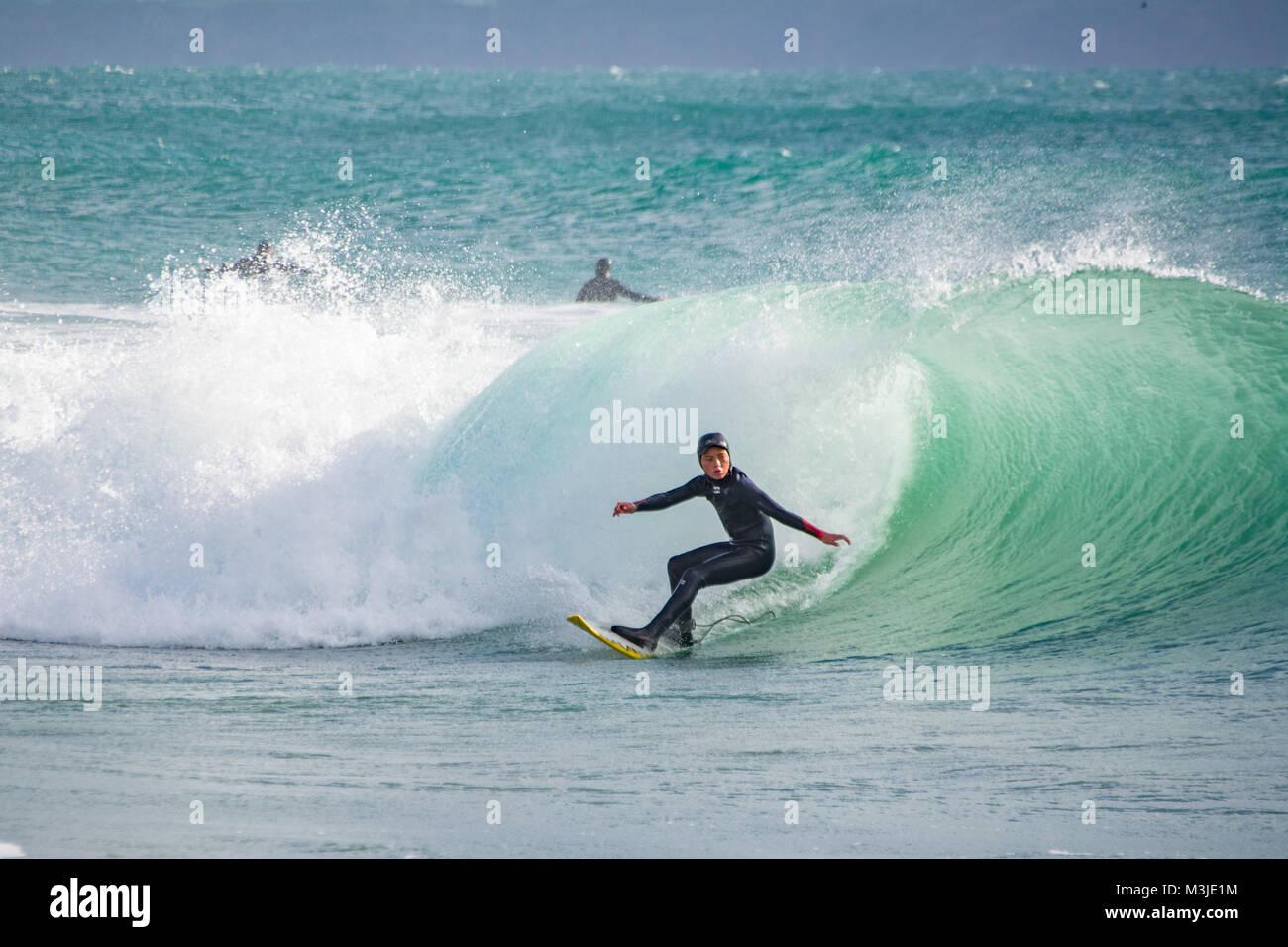 Praa Sands, Cornwall, UK. 11th Feb 2018. UK Weather. Dozens of surfers were out on the waves at Praa sands this - Stock Image