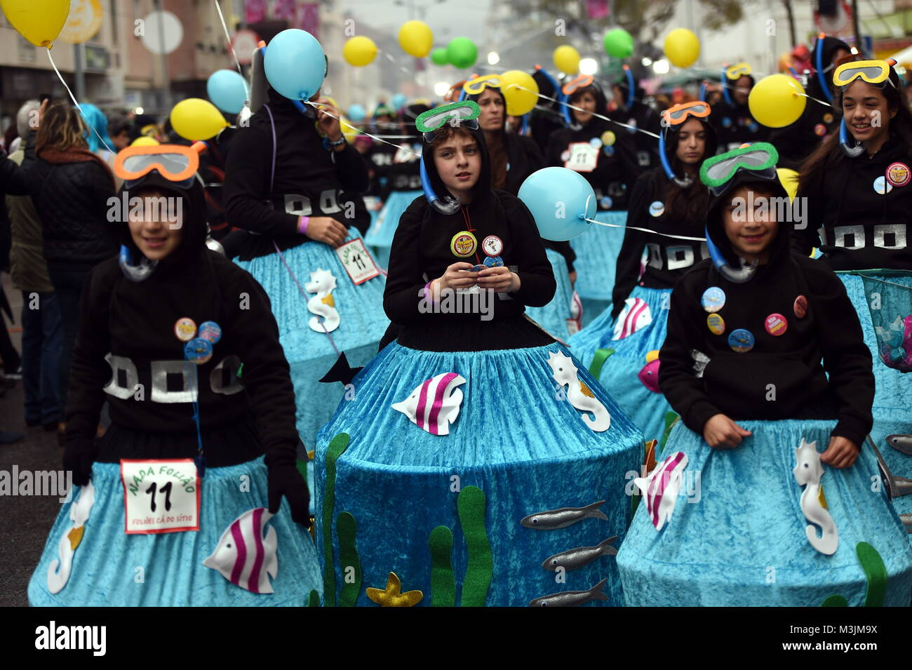 Lisbon, Portuguese capital Lisbon. 11th Feb, 2018. Revellers dressed in colorful costumes participate in the carnival - Stock Image