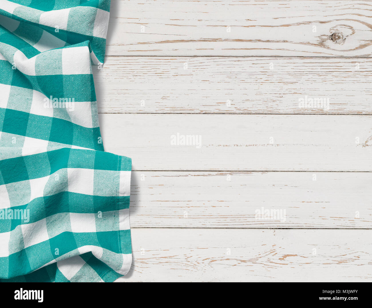 table with cyan picnic cloth top view background - Stock Image