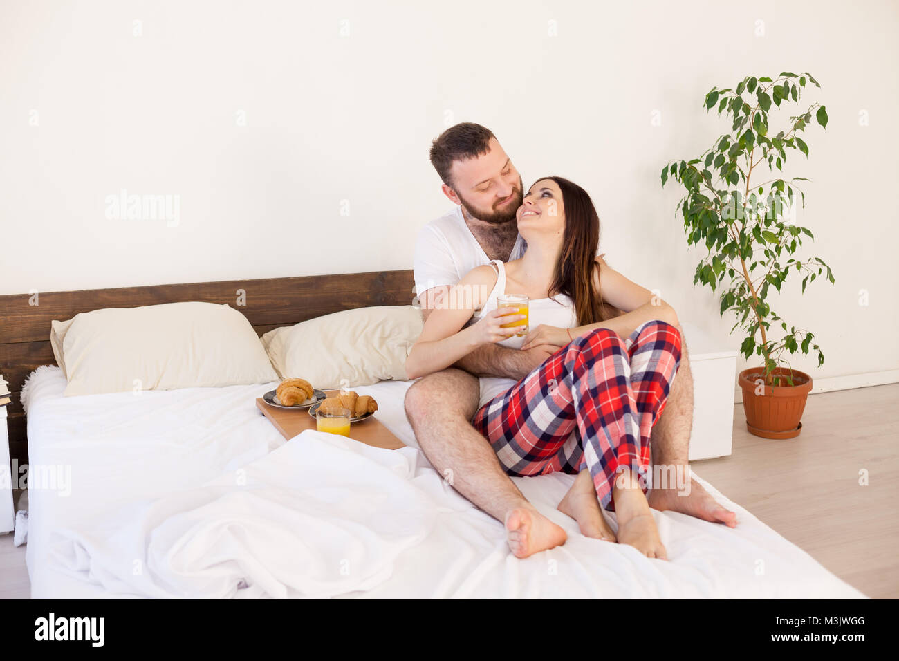 man and woman breakfast in bed - Stock Image