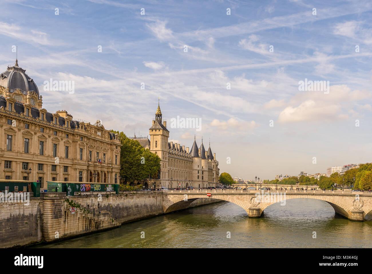 Color outdoor Paris cityscape photo of the bride Pont au Change over river Seine,view towards the commercial court,conciergerie,french - Stock Image