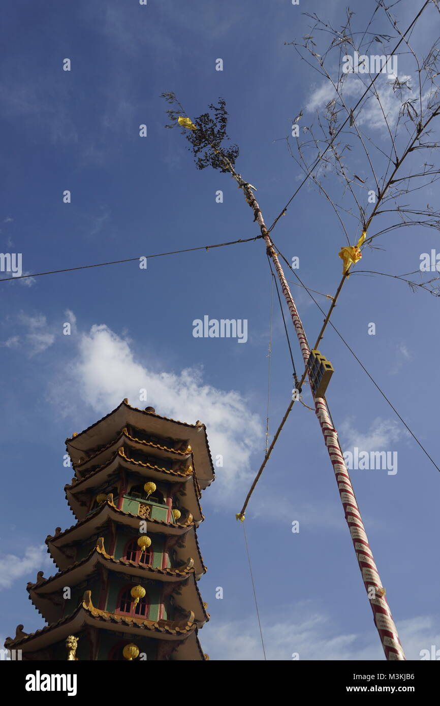 giant flagpole at Nine Emperor Gods Festival at temple in Ampang, Malaysia - Stock Image
