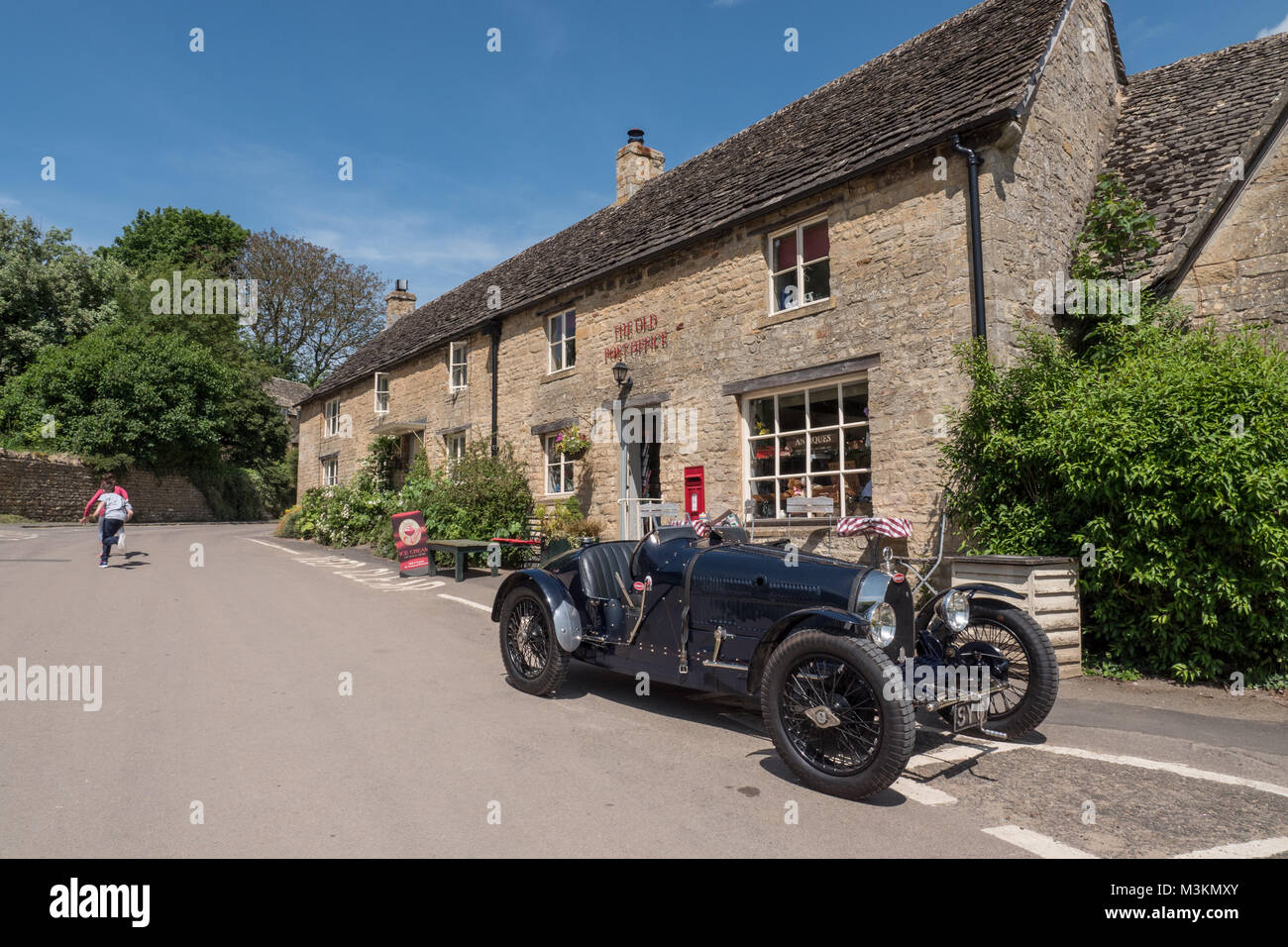 A classic 1927 Bugatti T37A sports car parked in front of The Old Post Office at Guiting Power, Gloucestershire, - Stock Image