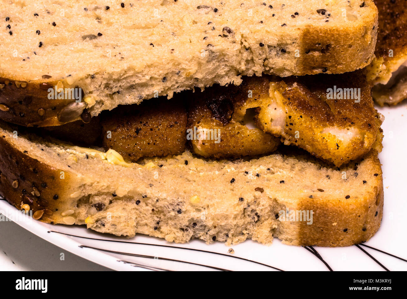 A fish finger sandwich. - Stock Image