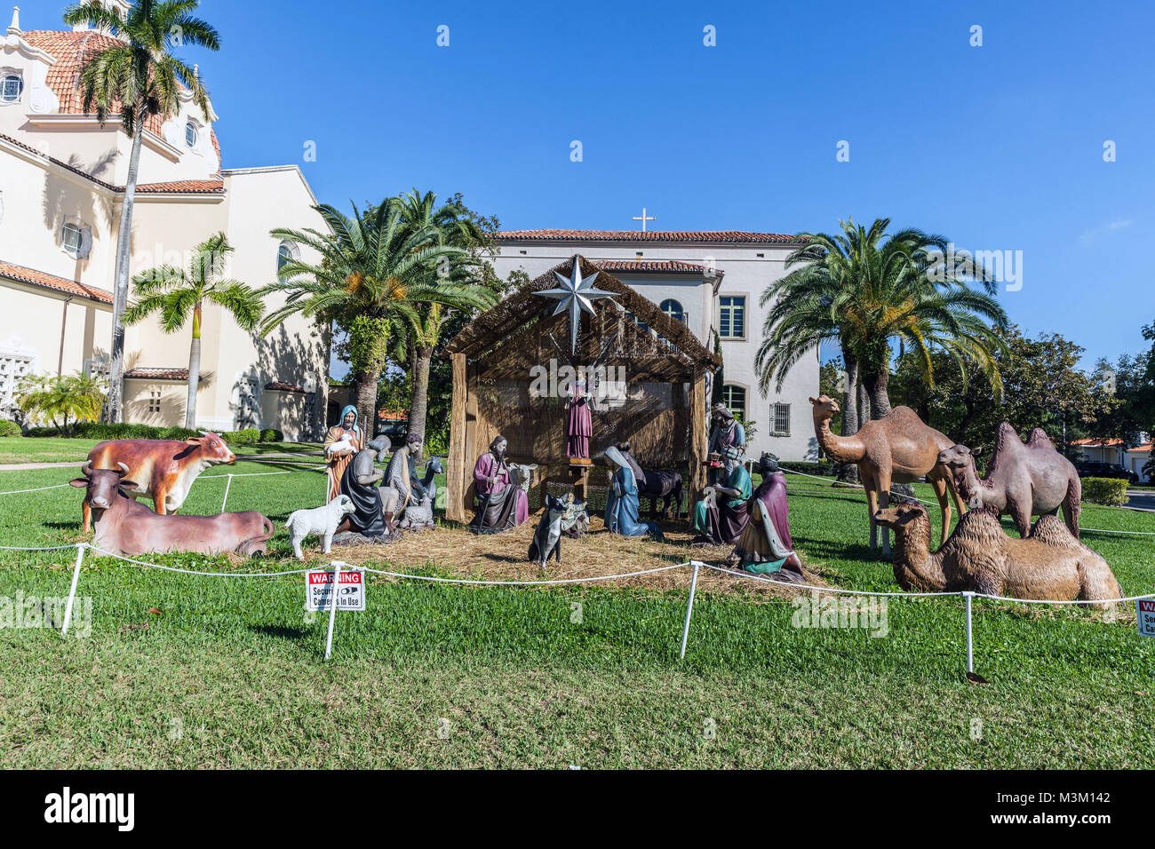 Life size Nativity scene outside the Church of the Little Flower, Coral Gable, Miami-Dade, Florida, USA. - Stock Image
