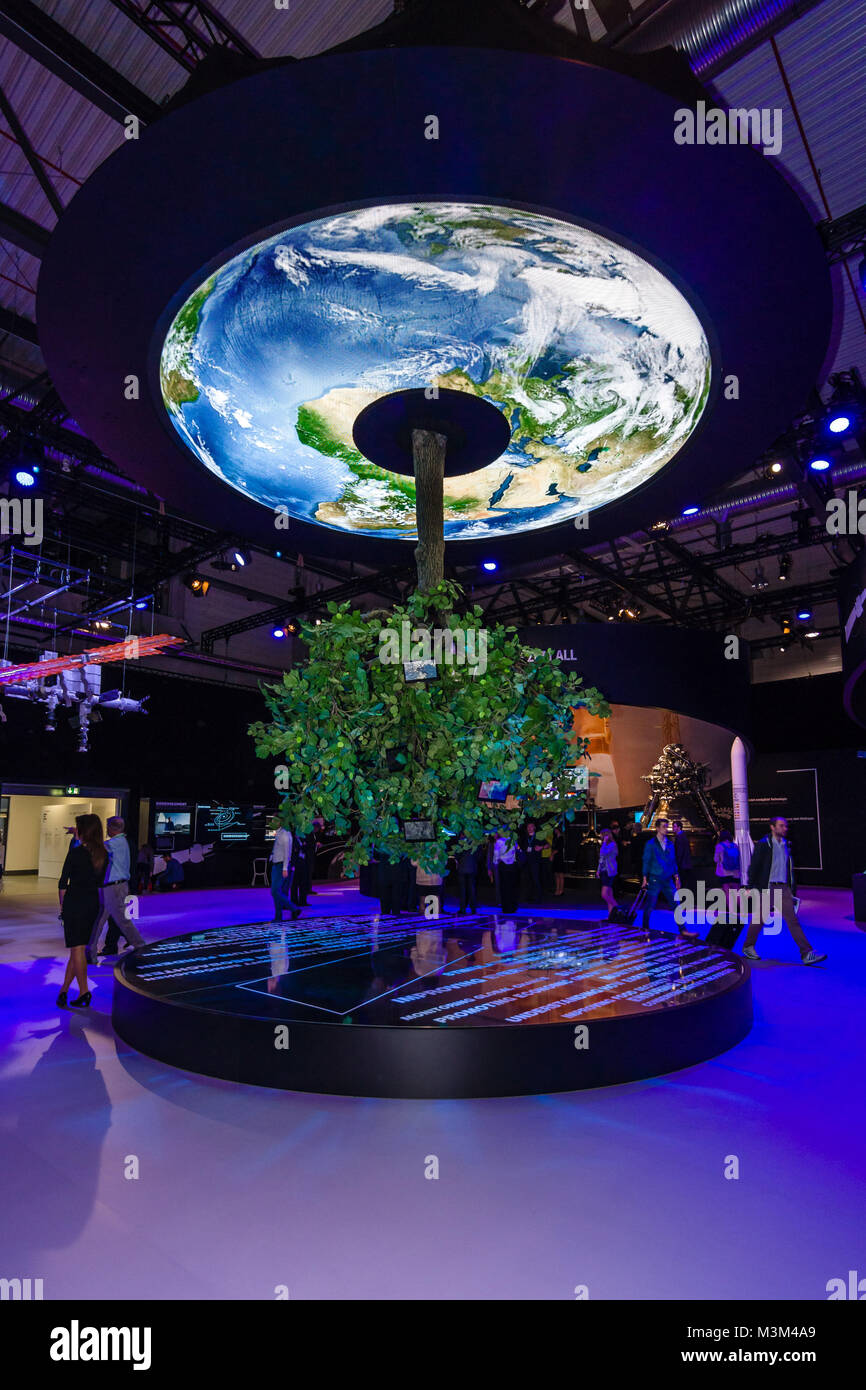 BERLIN, GERMANY - JUNE 01, 2016: Pavilion space. Model Earth and a growing green tree. Exhibition ILA Berlin Air - Stock Image
