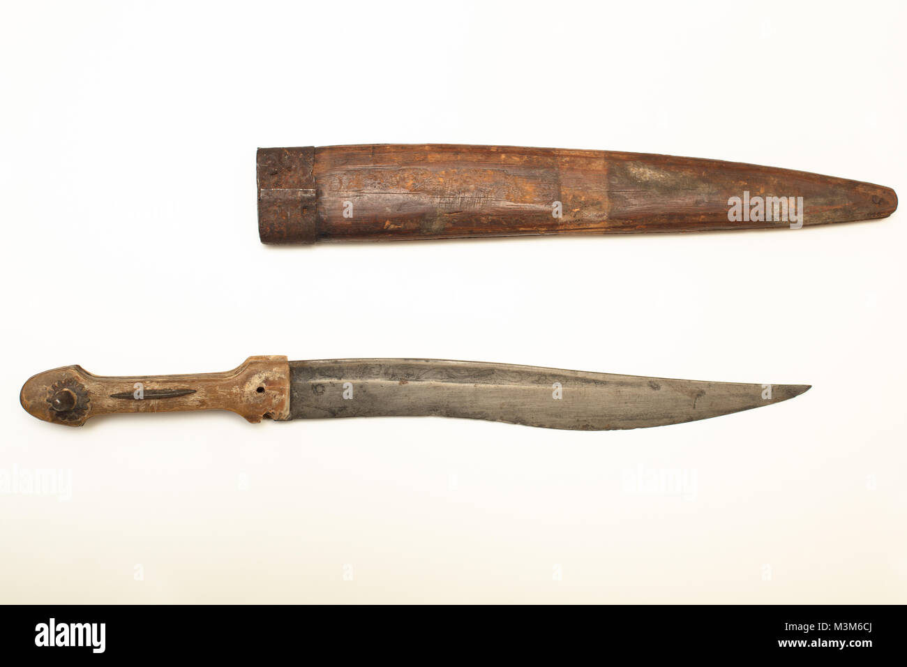 Old dagger with a wooden sheath to carry the weapon isolated on a white background with copy space - Stock Image