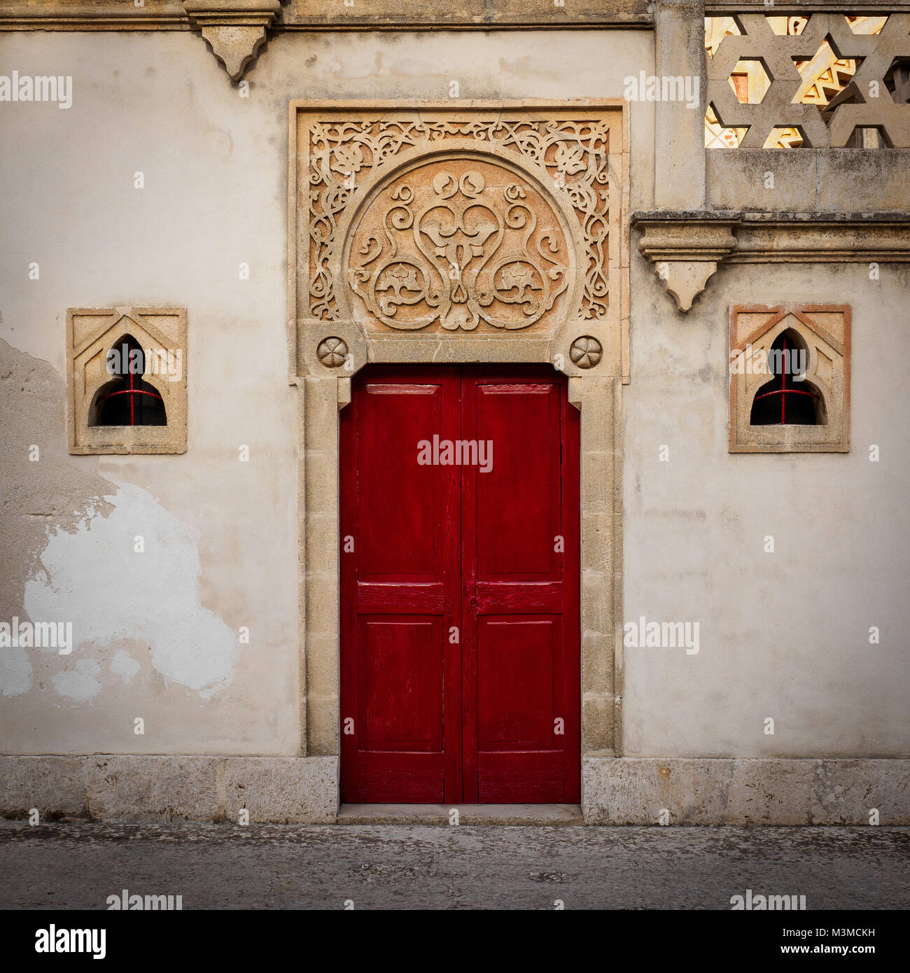 Santa Cesarea Terme (Italy), August 2017. Red door in Villa Sticchi, one of the best example of Moorish architectural - Stock Image