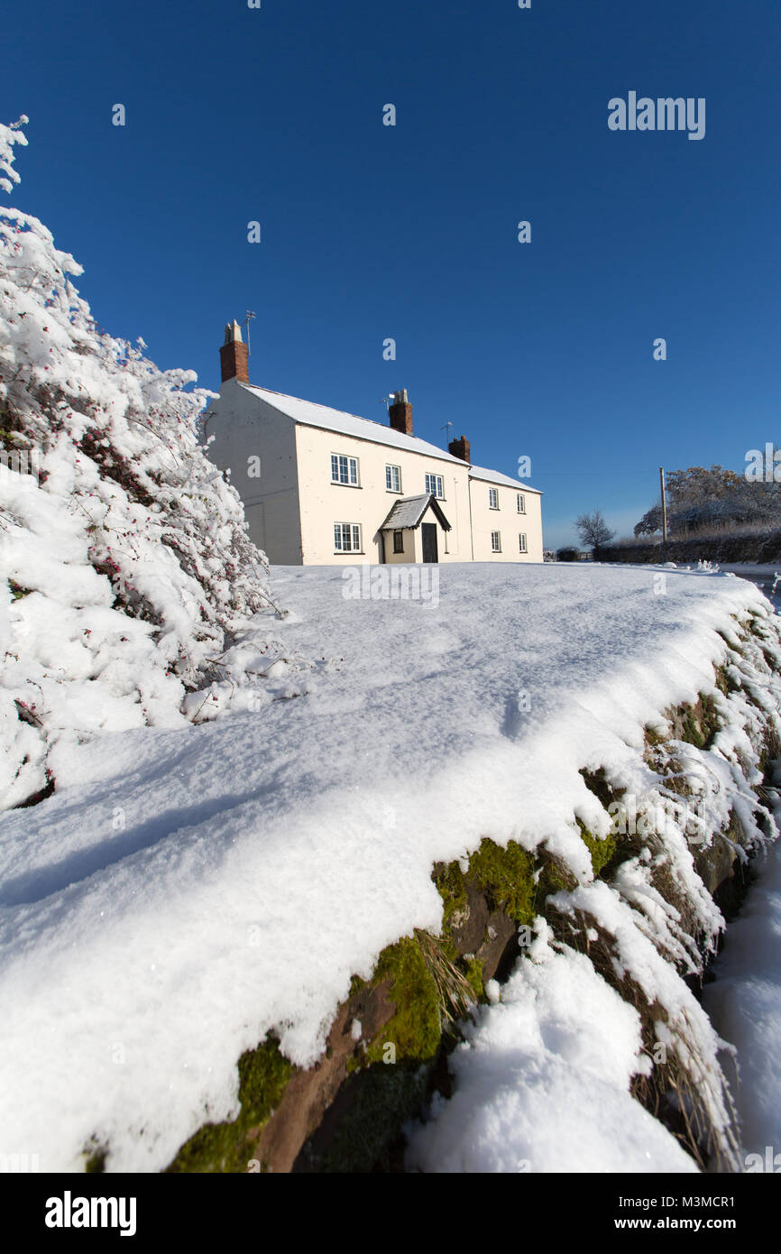 Village of Coddington, England. Picturesque winter view of a rural house, in the Cheshire village of Coddington. - Stock Image