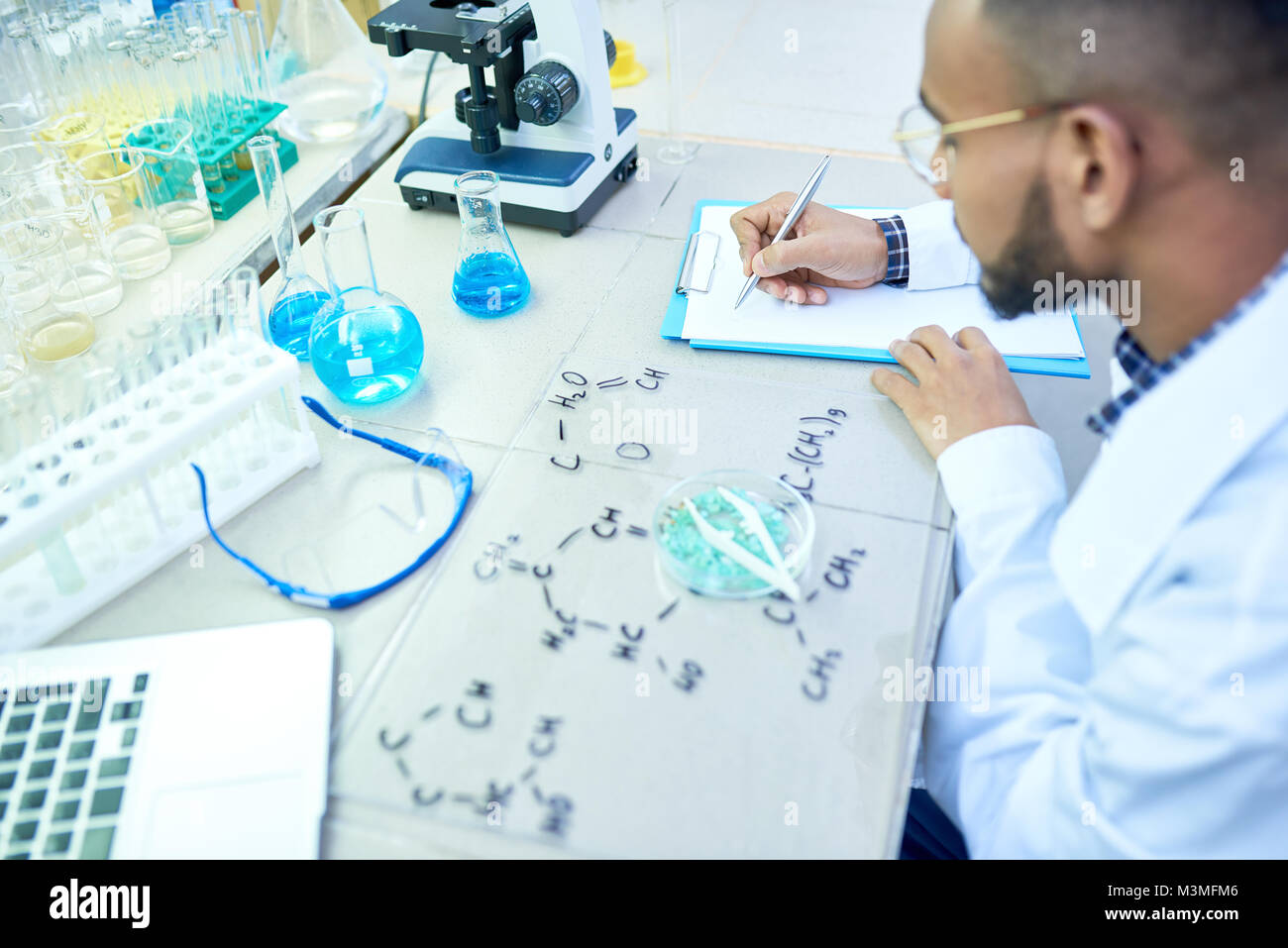 Middle-Eastern Scientist Working in Lab - Stock Image
