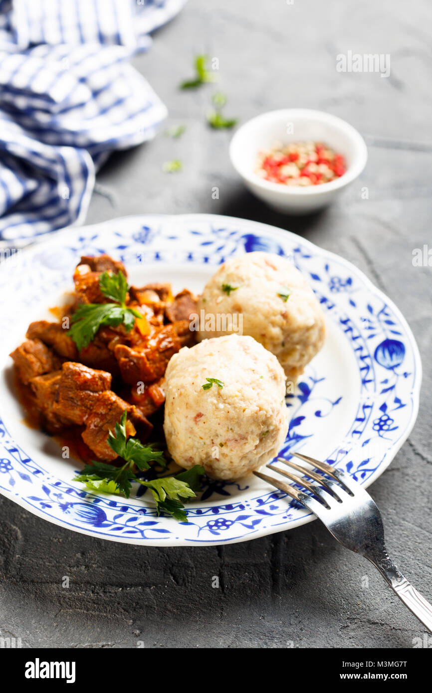 Dumplings with beef stew - Stock Image