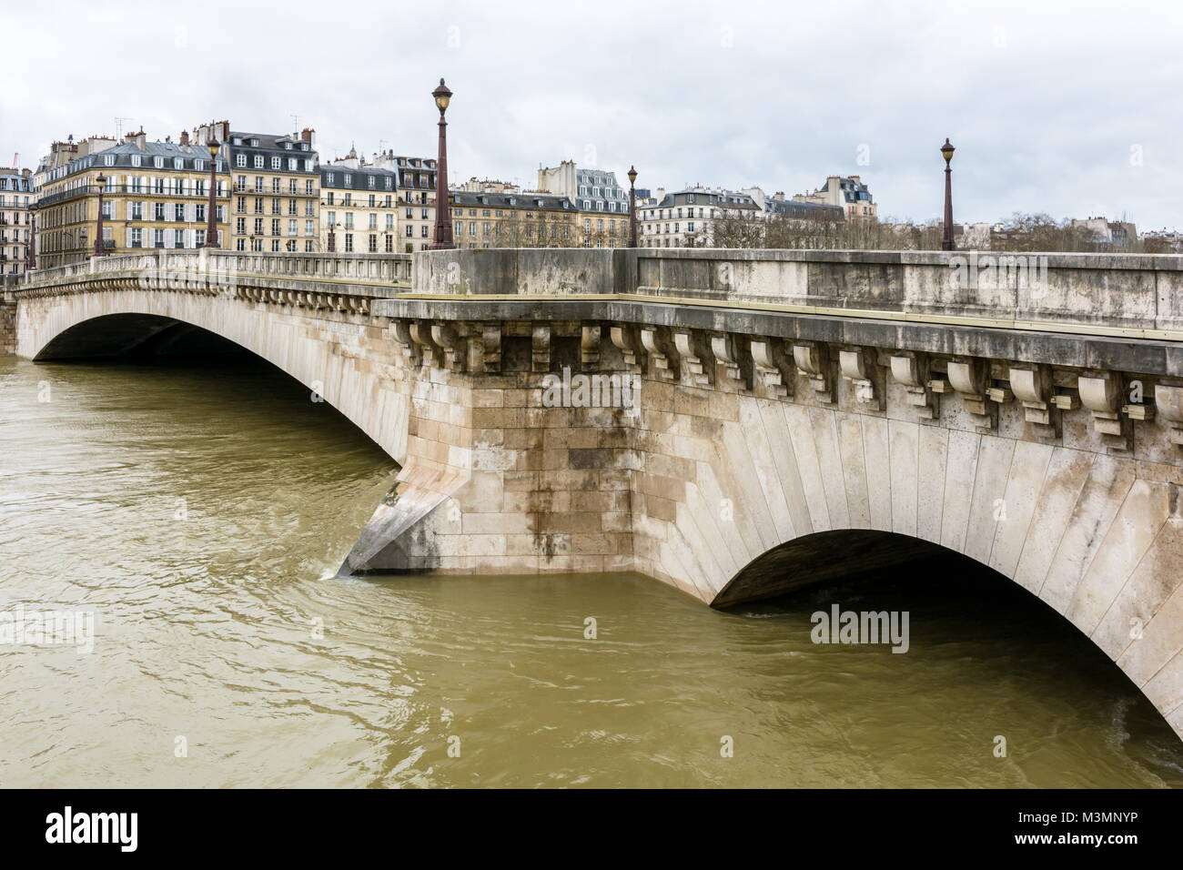 The Pont De La Tournelle In Paris Between The Saint Louis