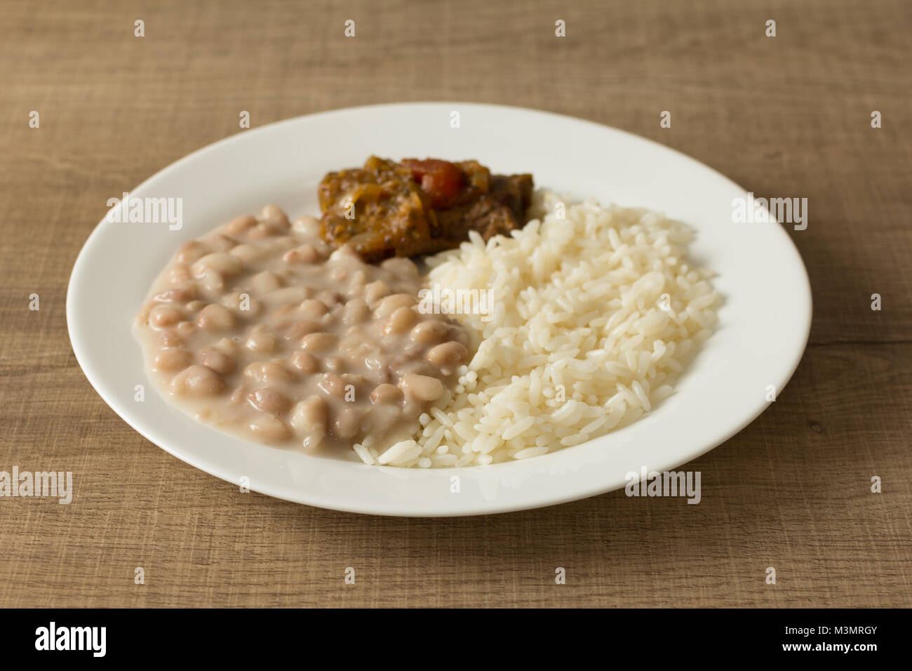 Meal With White Rice Pinto Beans And Meat With Sauce White Dish On Stock Photo Alamy