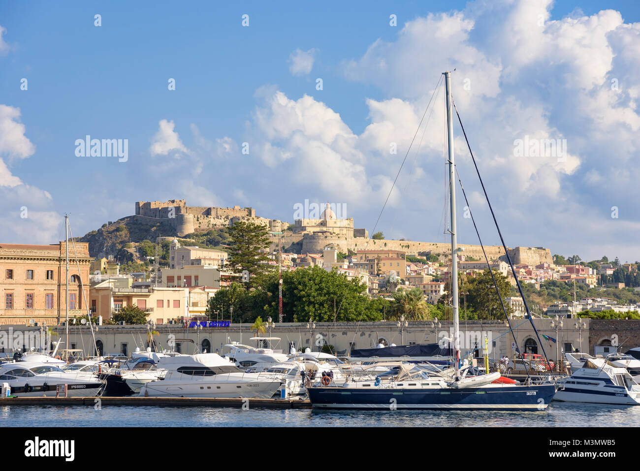 Milazzo, Italy - August 22, 2017: View of the port in Sicilian town with Milazzo Castle in the background Stock Photo