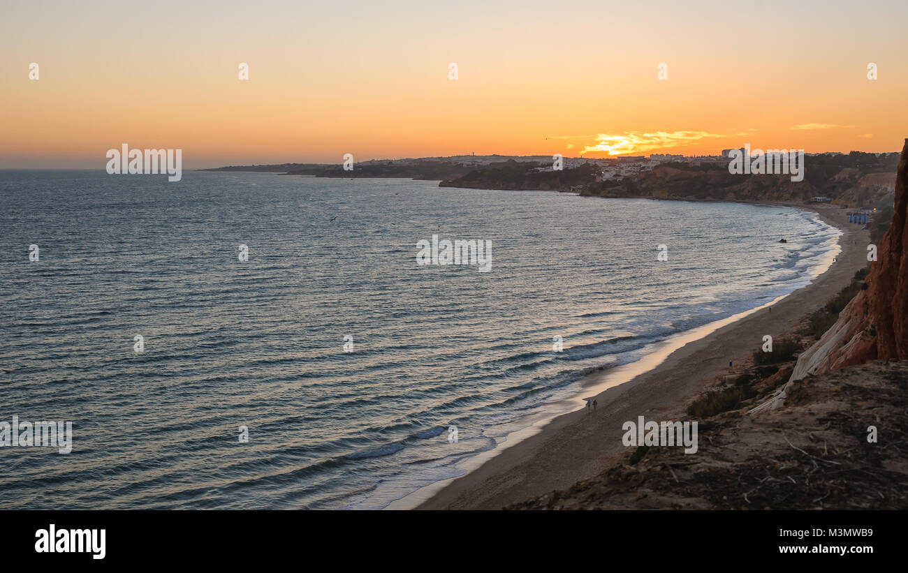 Atlantic coastline in Algarve region in Portugal at dusk Stock Photo