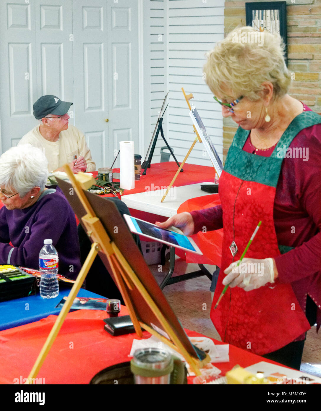 Retirees enjoy life by getting out taking painting classes