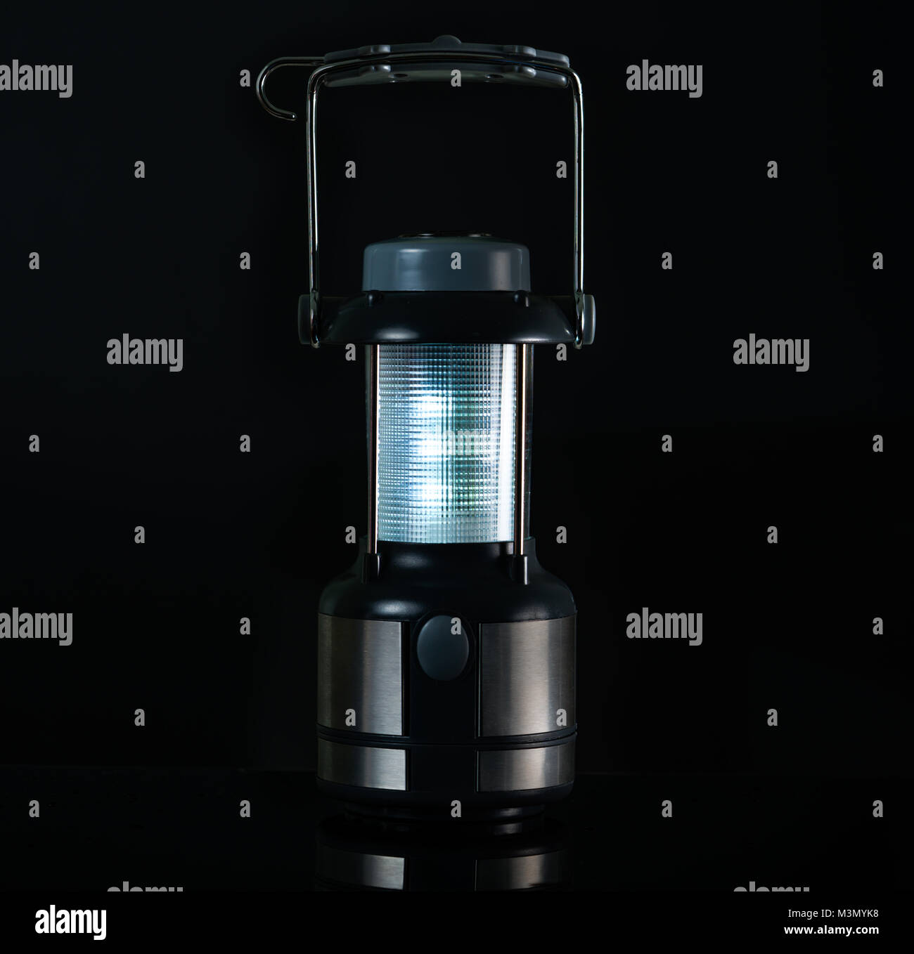 Camping lamp isolated on white background with copy space for text. Electric LED lantern with compass and handle - Stock Image
