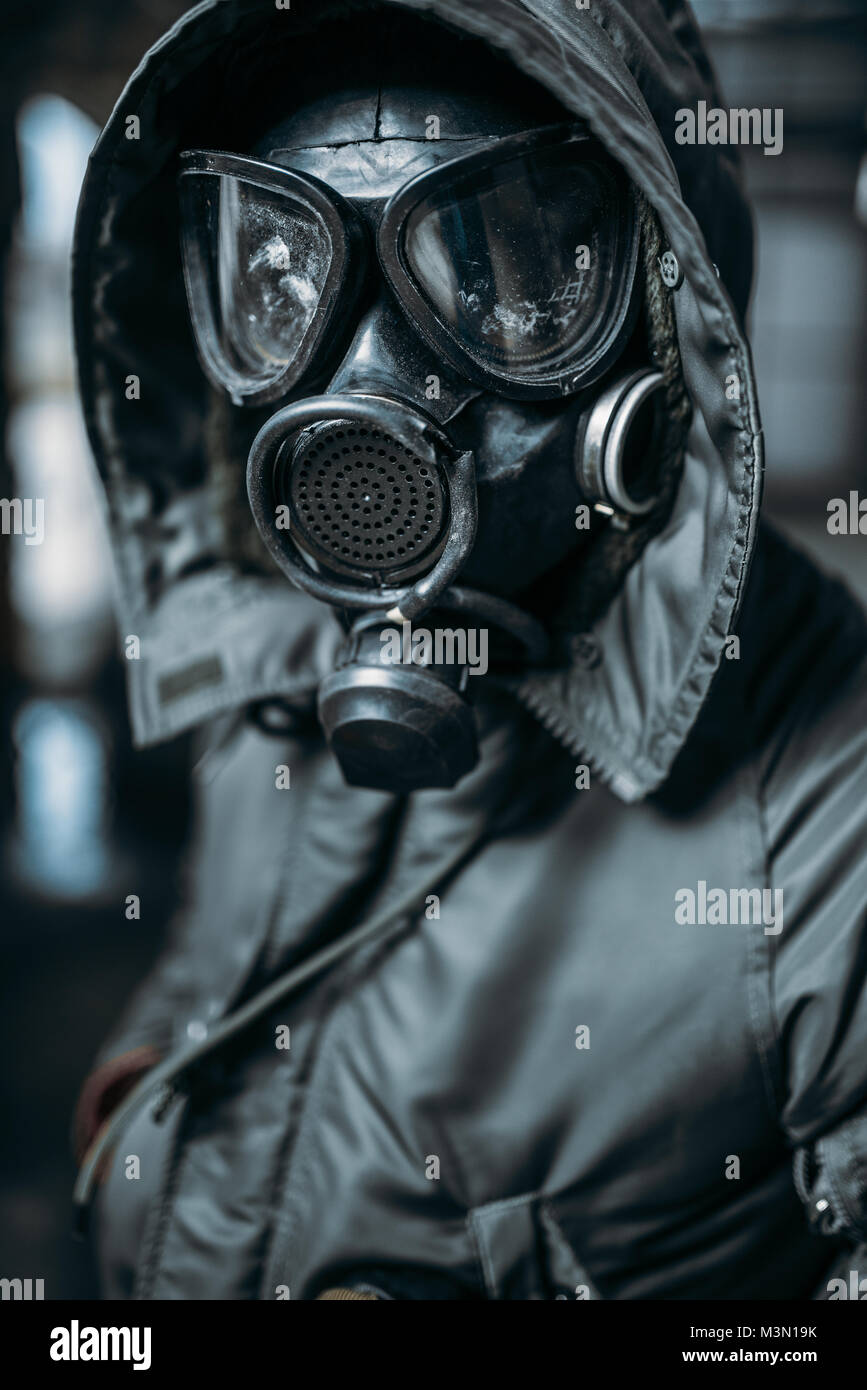 Stalker concept, male person in gas mask, radiation danger. Post apocalyptic lifestyle, doomsday, horror of nuclear - Stock Image