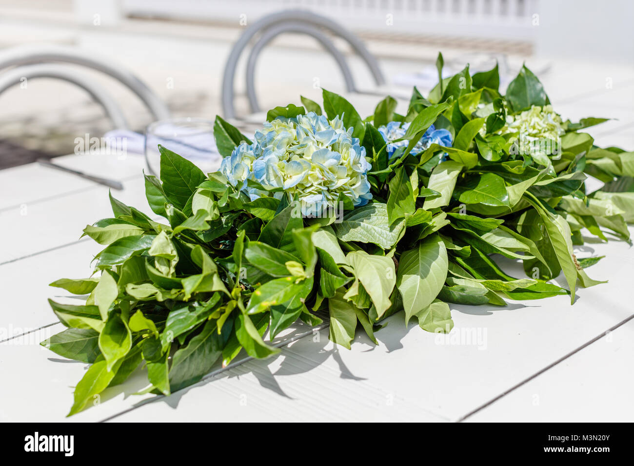 White Table With Hortensia Flower Bouquet For A Wedding Set Up White Stock Photo Alamy