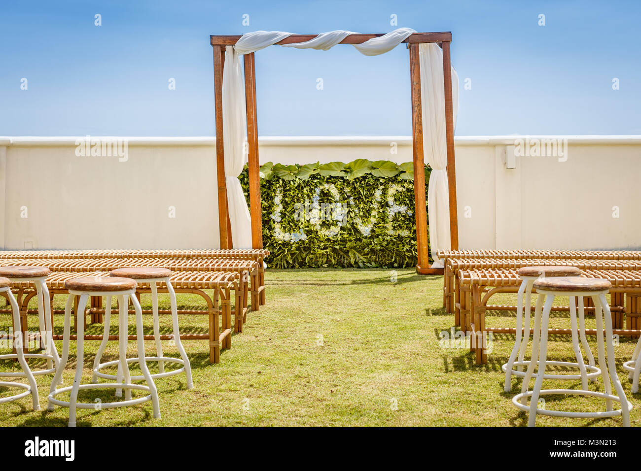 Wooden wedding arch for a ceremony decorated with white fabric Stock ...