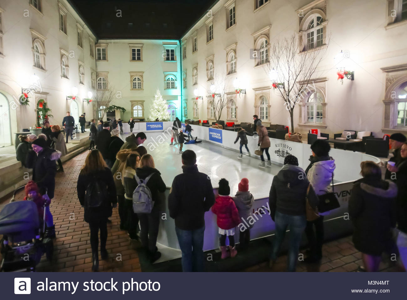 ZAGREB, CROATIA - DECEMBER 1th, 2016: Advent time in city center of Zagreb, Croatia. People ice skating at the synthethic Stock Photo