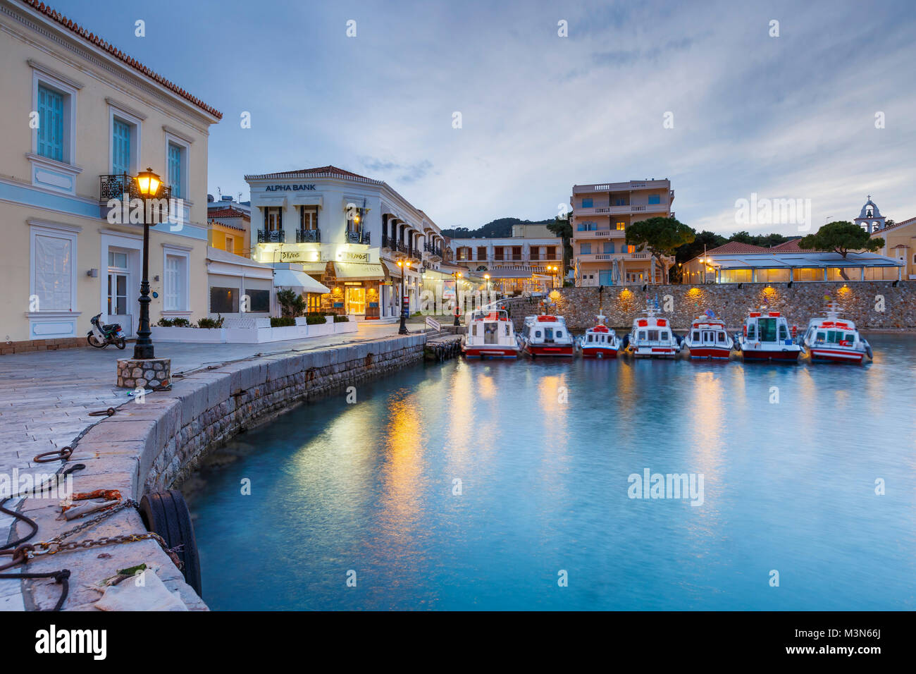 Houses in the harbor of Spetses, Greece. - Stock Image