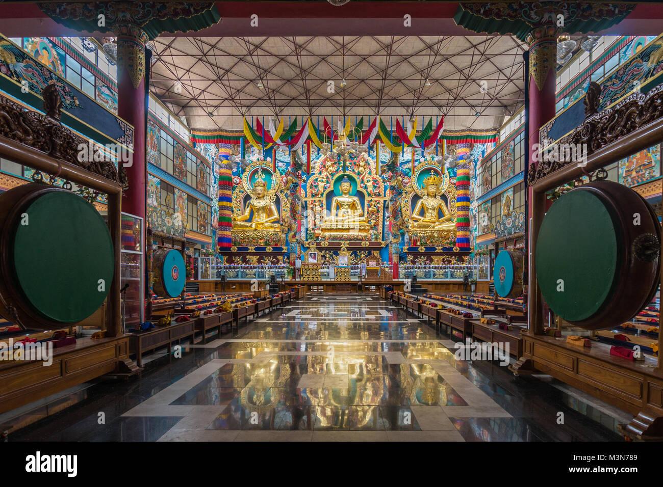 Coorg, India - October 29, 2013: Inside Padmasambhava Vihara of Namdroling Buddhist Monastery. The golden statues Stock Photo