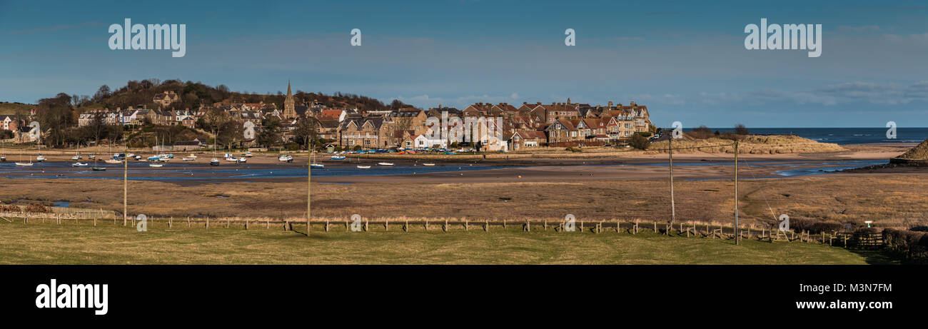 Northumberland coast seascape, a panoramic view over the seaside village of Alnmouth, within the Northumberland - Stock Image