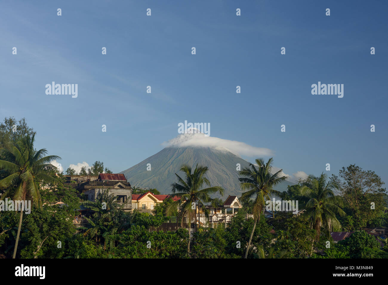 A cloud blanket over the tip of Mount Mayon volcano near Legazpi City, Albay, Philippines. - Stock Image