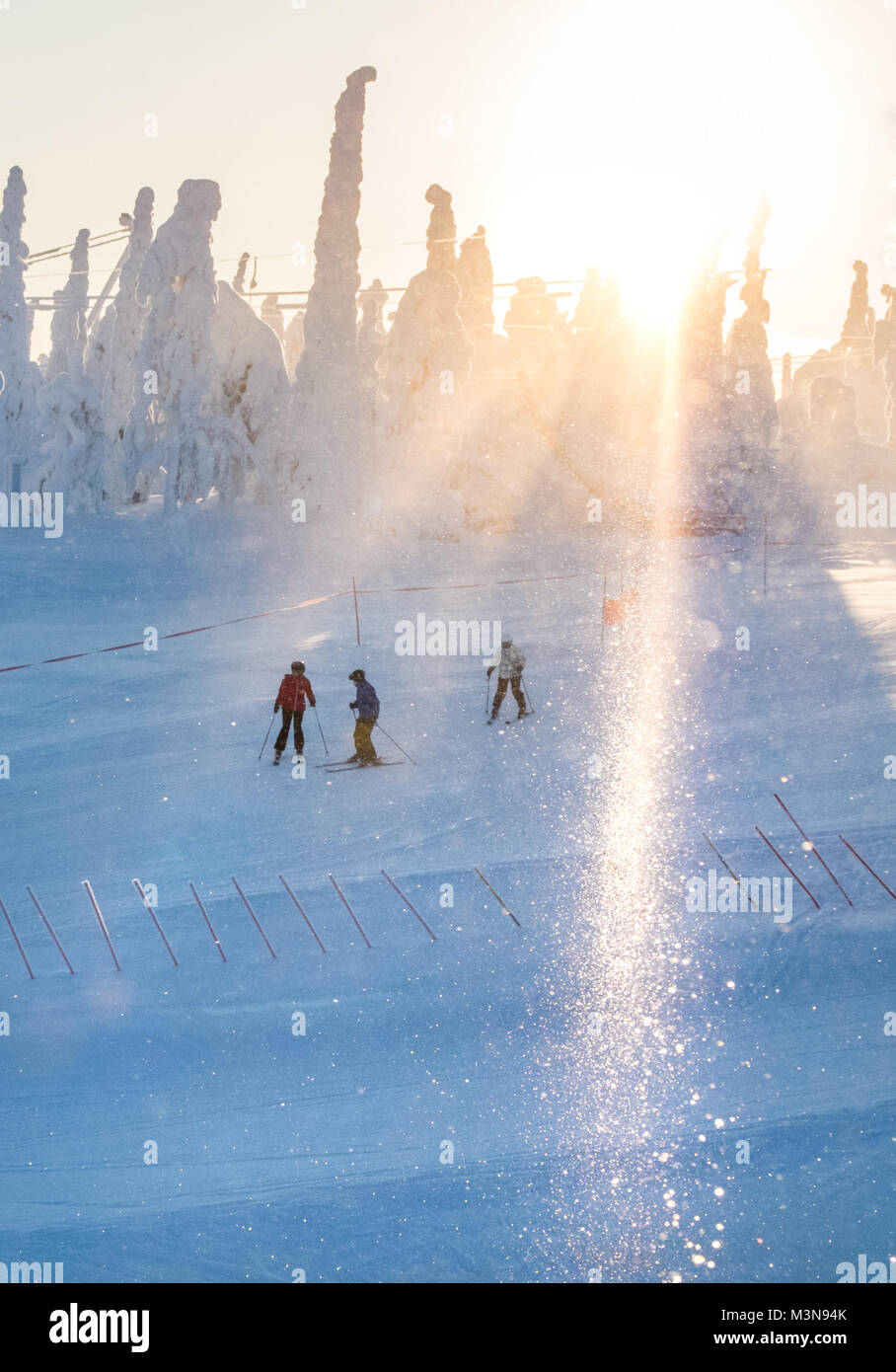 Skiers on the piste at The ski resort of Ruka in Finland Stock Photo