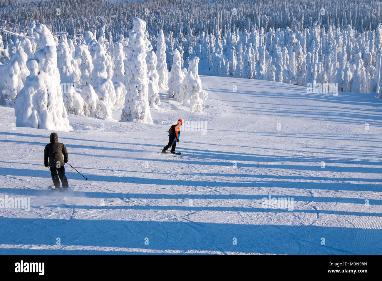 Skiers on piste atThe ski resort of Ruka in Finland - Stock Image