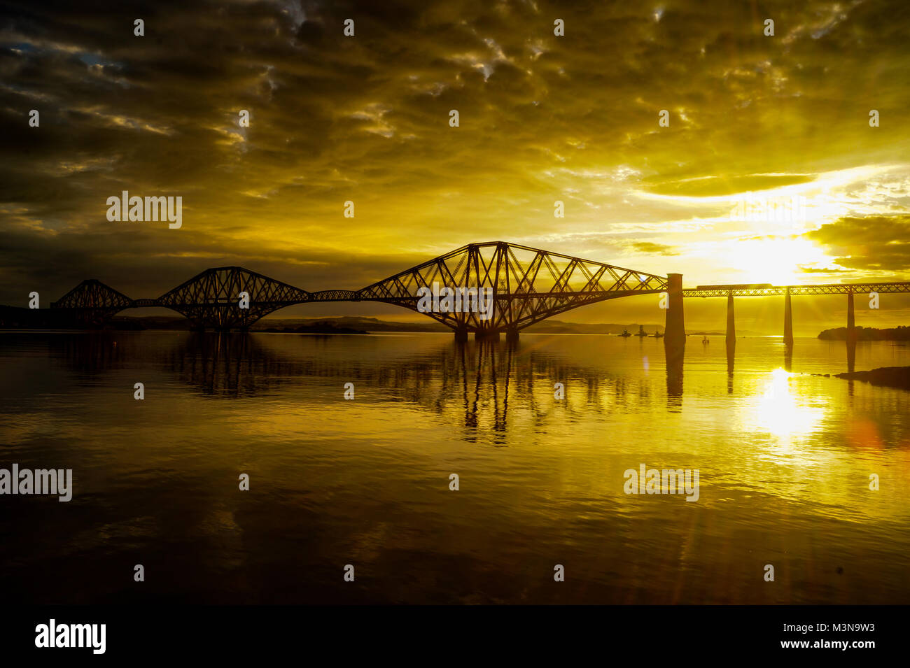 Forth Rail Bridge during golden hours. - Stock Image
