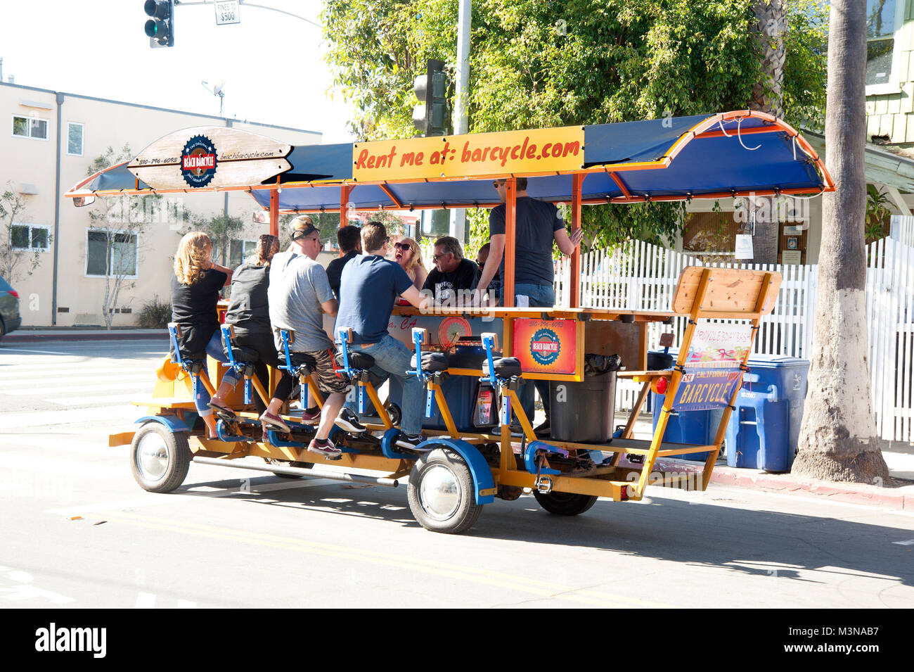 Barcycle, a bar on wheels with patrons cycling in Santa Monica CA - Stock Image