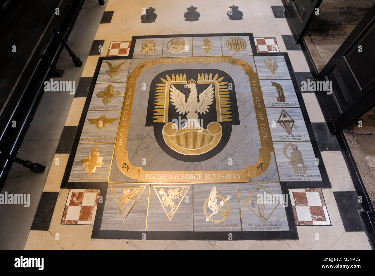 The Polish Air Forces memorial on the floor of the Baroque  St Clement Danes church built 1682 by Christopher Wren - Stock Image