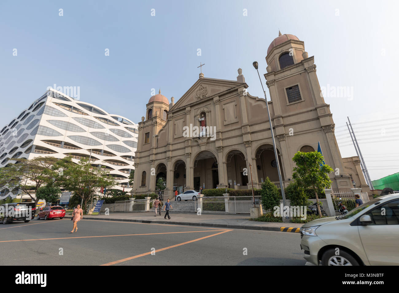 Manila, Philippines - Feb 10, 2018 : Facade of catholic churches beside in the Mall of Asia shopping mall of Pasay - Stock Image