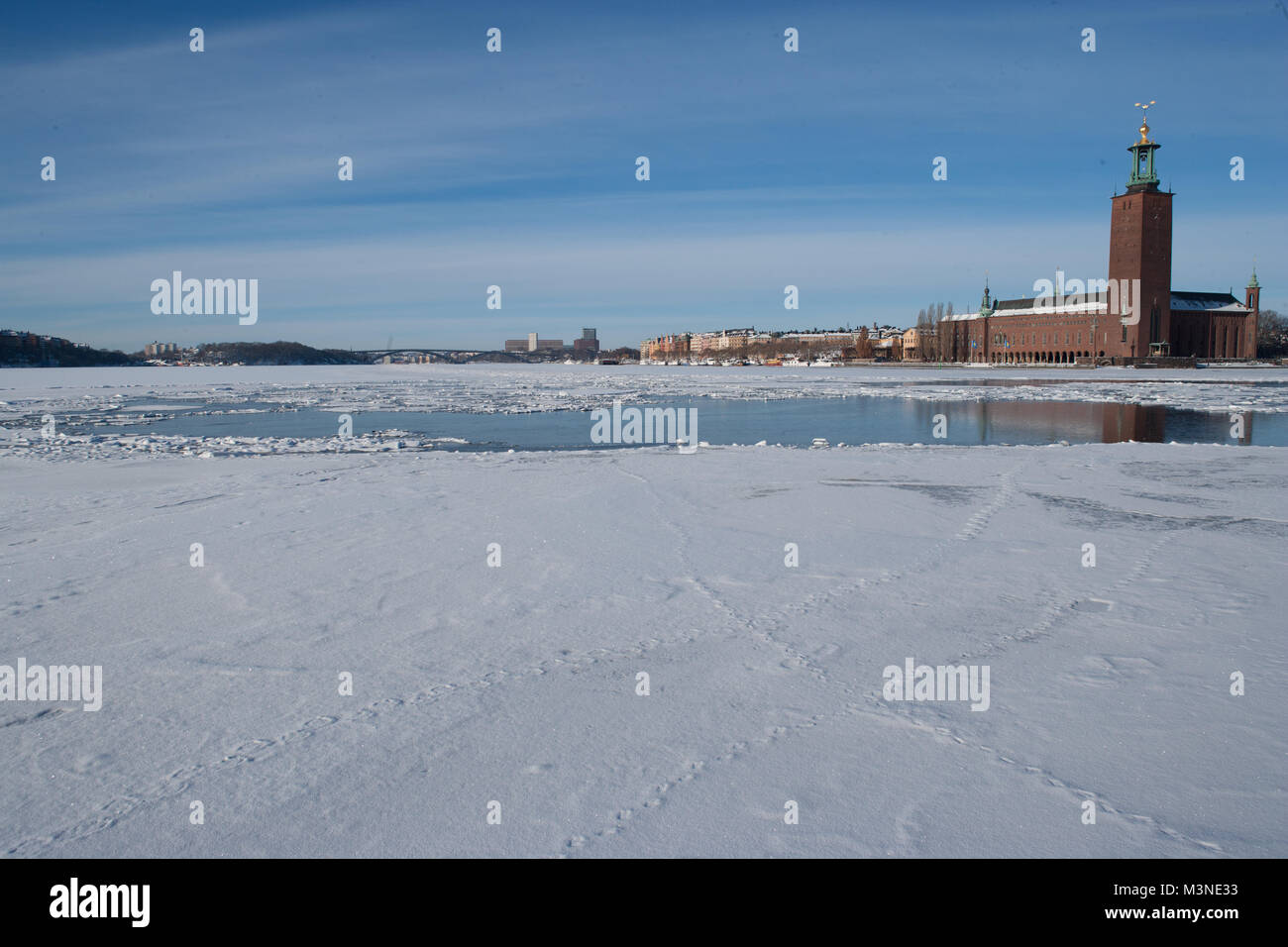 View of Stadshuset in Stockholm across a frozen Mälaren - Stock Image
