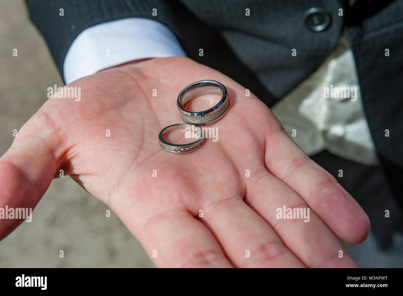 Hand of marriage showing the bride and bridegrooms wedding rings ...