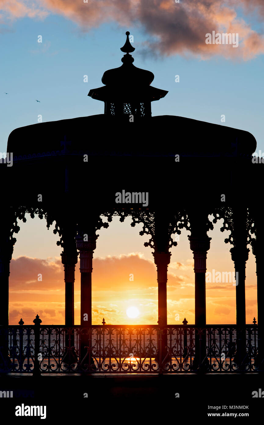 The Bandstand on Brighton and Hove's seafront first opened in 1884 and is considered to be one of the finest examples - Stock Image