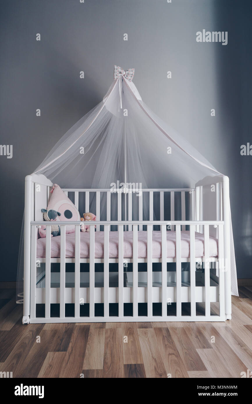 Shot of a modern grey nursery room - Stock Image